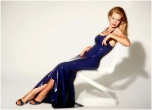 Jeri Ryan lounging in Tulip Gown by Syren Latex