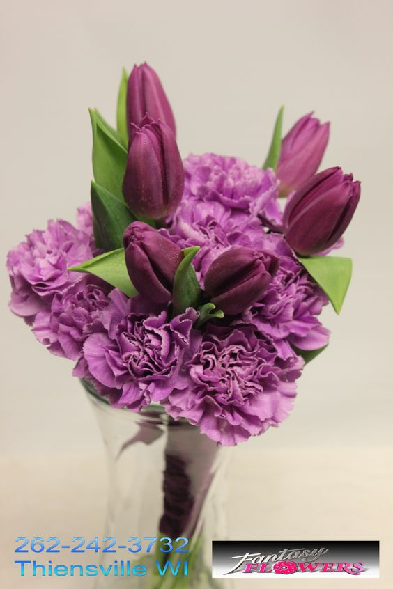 Plum gowns, with these lilac colored carnations.  Fantasy #Flowers #Thiensville #Bridal #Bouquet 262-242-3732