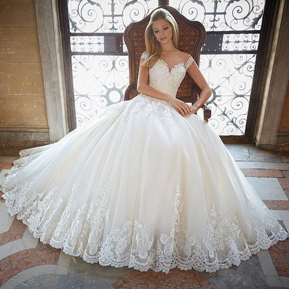Wedding gown by Mori Lee (Style 2889). Touches of lace at the bottom with a soft…