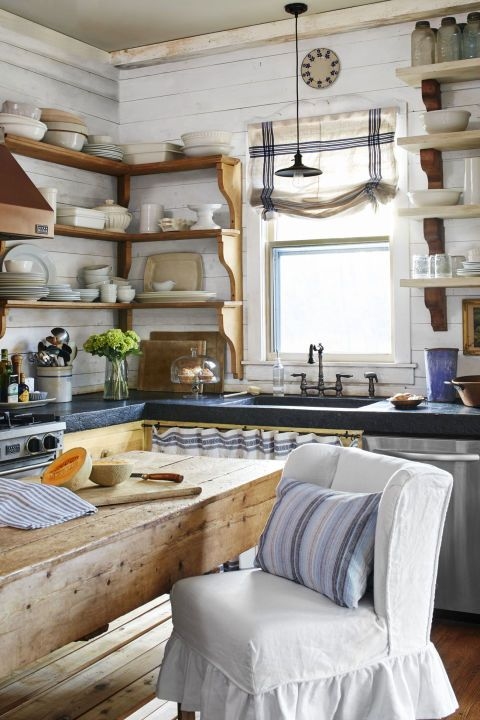Blue and white accents in a gorgeous kitchen with European country style. #kitchen #european #cottage #blueandwhite #shelves