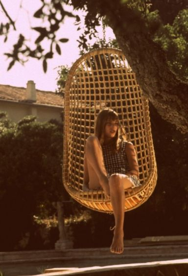 Jane Birkin in wicker hanging chair ,