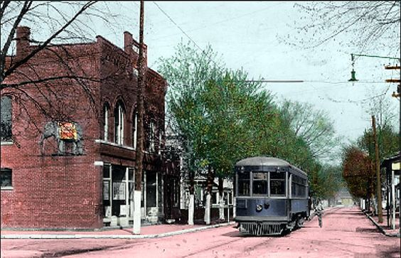 a Hocking-Sunday Creek Traction Co. Electric Rail-car traveling on the East End on Chestnut Street. The Traction Car is just passing J.P. Reynolds Bldg. on the corner of Chestnut and Harper Streets,