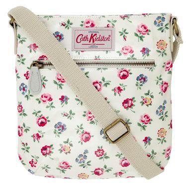 Our little pocket bag is perfect for those who like to travel light, with just enough room for the essentials. It has a zipped front pocket, leather trims and an adjustable strap. This fully lined, wipe clean bag comes in our pretty Linen Sprig print.