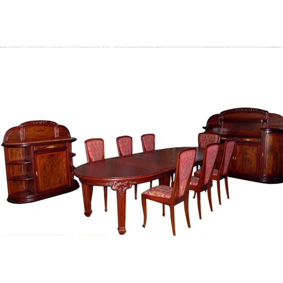 "Spectacular French nine-piece Art Nouveau Dining Suite ""Le Vigne"" By Louis Majorelle. Art Nouveau furniture began in France around 1890 often taking its motifs from plant life and the human female form. The wood carvings and bronze hardware generally matched each other in terms of motif."