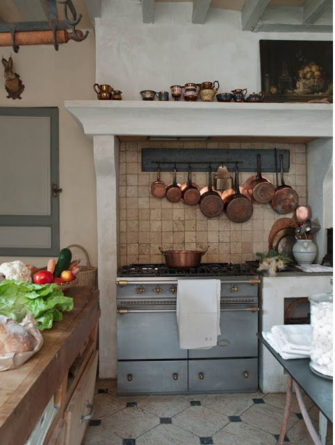 Thick wood butcher block counter, copper, mantle piece/alcove, floor.
