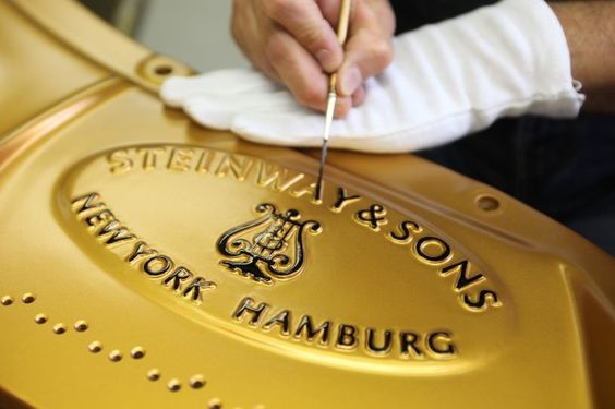 Steinway & Sons - Painting the cast iron plate, by hand.