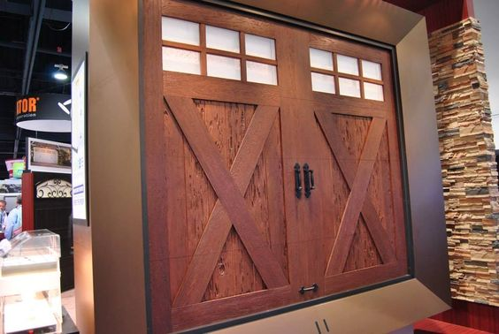 Carriage style garage doors garage doors and overlays on for Garage door wood overlay