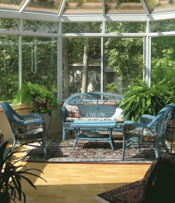 plants for sunrooms | Side Of Sunroom Decor With Blue Arm Chairs And Table And Indoor Plant ...