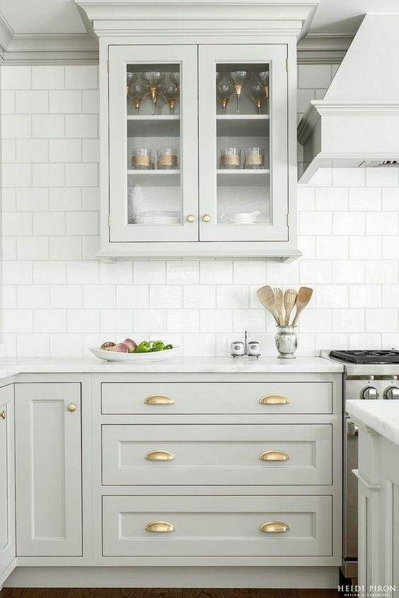 Heidi Pirron Gray Kitchen with Brass hardware and white brick pattern tile. #brasshardware #binpulls