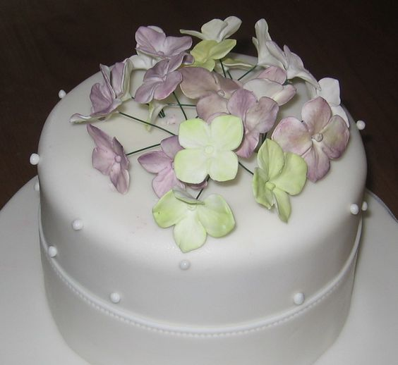 Handmade edible lilac and apple green hydrangea by cakeascanvas