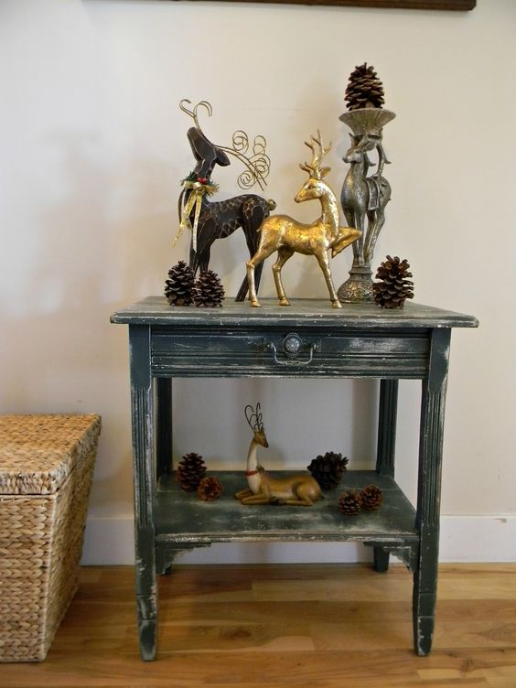 Vintage reindeer add a woodsy touch to a corner table....even when it's not Christmas.