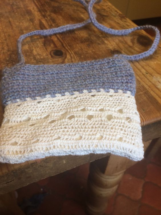 Scrap if vintage cotton doilly from a junk shop plus done crochet to make a little zippy purse and strap