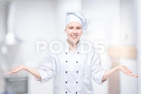 Cheerful Girl Cook Posing In The Studio On The Background Of The