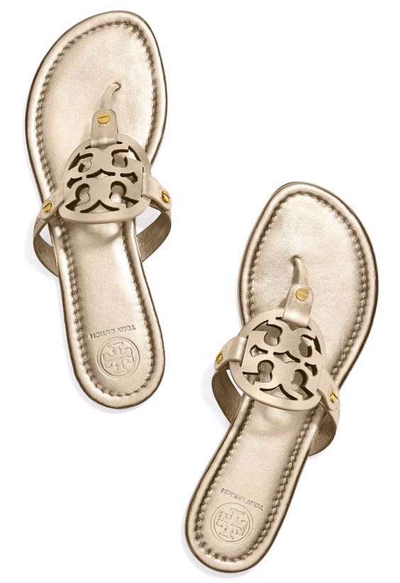Love these gold Tory Burch sandals