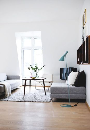 the grays with the single color again, but i like the introduction of wood here.  damn that lamp cord though - either express it openly or make it disappear: Floor Lamps, Interior Design, Living Rooms, Living Spaces, Coffee Table, Livingroom, Aj Lamp, Grey Sofas