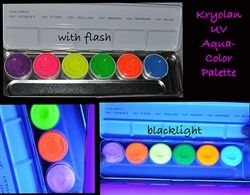 http://www.directglow.com/Kryolan_AquaColor_Blacklight_Fluorescent_Body_Pain_p/k5177.htm Each color fluoresces brilliantly under black light, making them perfect for special black light effects. Aquacolor Day Glow Effects are non-grease, compact colors. It has good covering characteristics and is easily applied with a damp sponge or brush.  When applied it should be carefully rubbed with the hand or a soft cloth. Aquacolor Day Glow effects can be easily removed with soap and water.