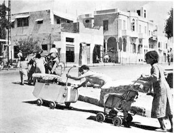 Jaffa, Palestine: Palestinian residents salvage whatever possessions they can carry as they flee the city. (viaWalid Khalidi, Before Their Diaspora)