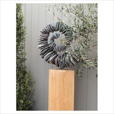 Spiral rock sculpture...(no Diy) drill through stones, thread wire, twist to desired shape. Attach to a post.