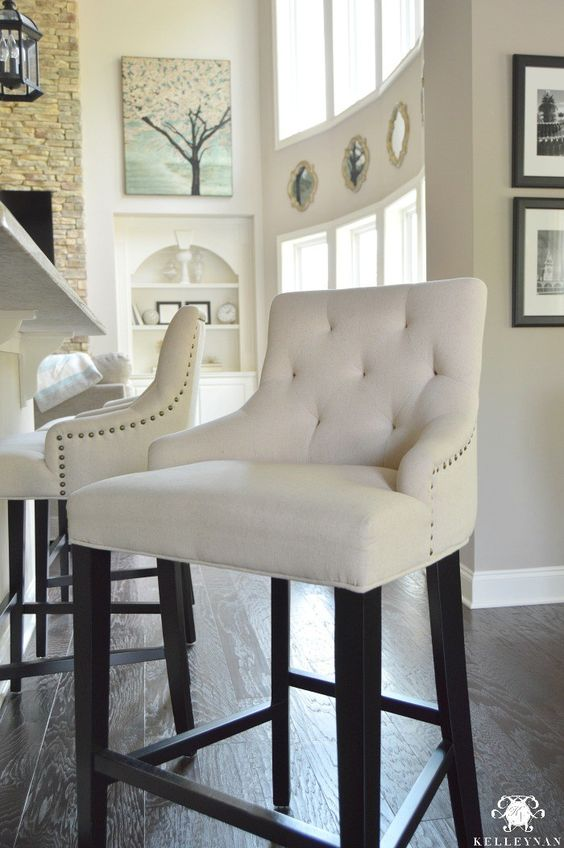 Kelley Nan: Best Chair Sale EVER-  You can get this tufted, nailhead trim bar stool for $111 RIGHT NOW- I've never seen a price on these this low!