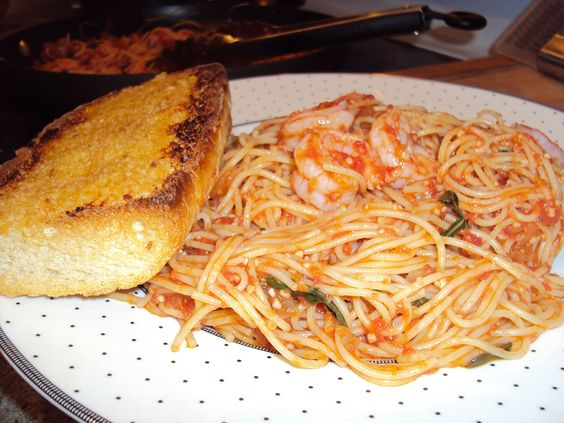 My homemade heirloom tomato pasta sauce served over angel hair and ...