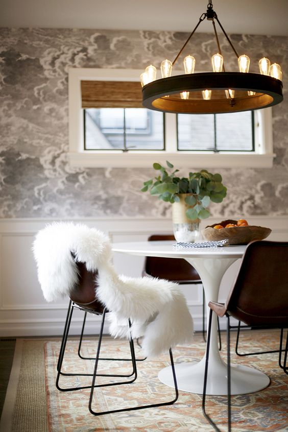 Saarinen table and bold wall covering, pair perfectly with the warm leather side chairs and traditional wainscoting.:
