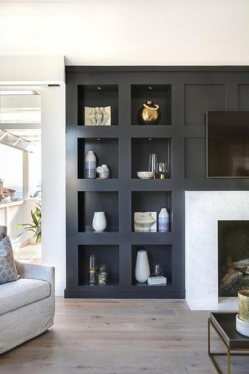 Custom Black Niche Bedroom Built In Wall Shelf Surrounding A White Marble Fireplac Living Room Decor Traditional Living Room Remodel Neutral Modern Living Room