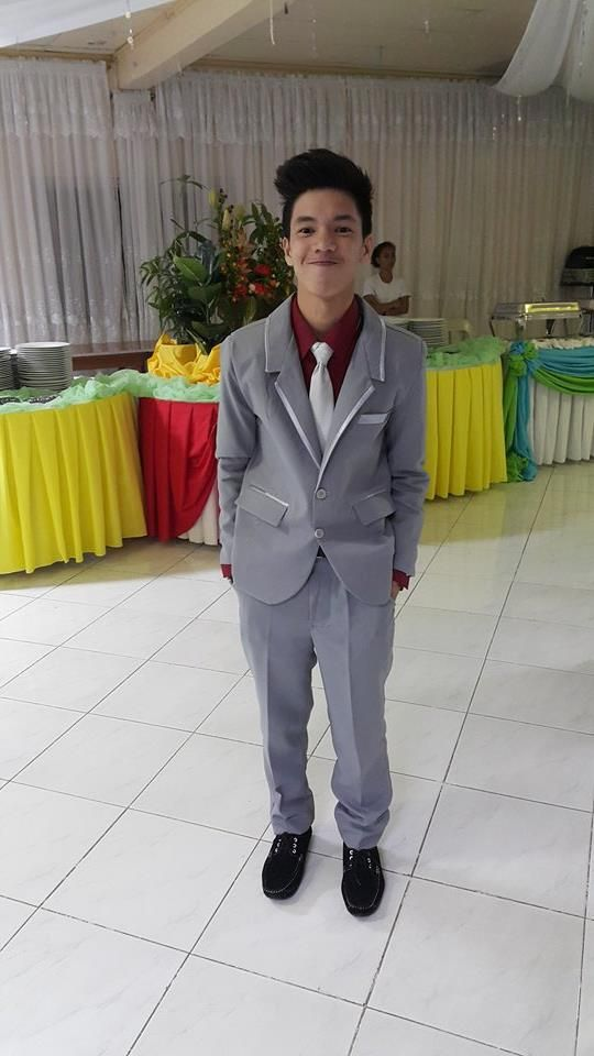 Gray suit with Red longsleeves and white neck tie
