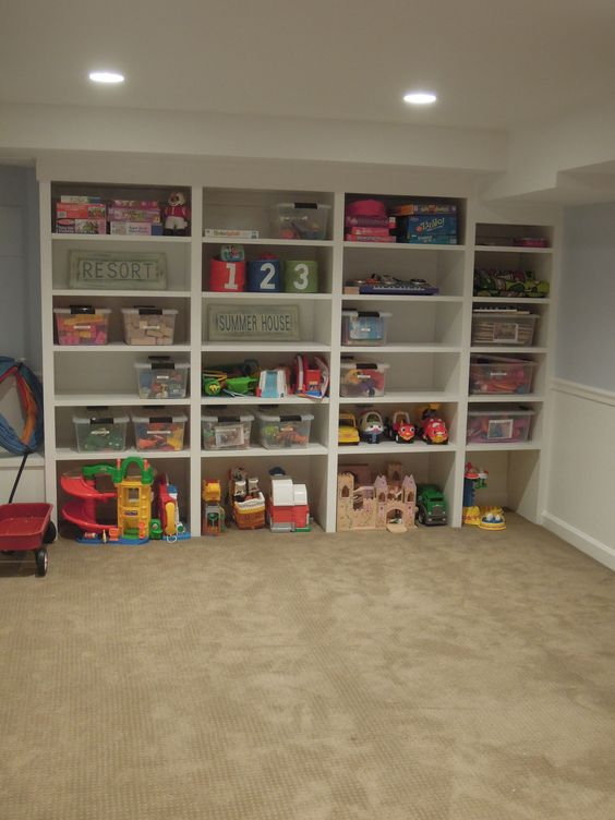 Toy storage - I have a bookshelf like this in the den but its filled with books.....thinking its transformation time