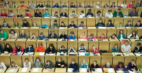 HIGHER LEARNING: Children sat in a lecture hall at Martin Luther University in Halle, Germany, Tuesday. The children's program started with an introduction to mathematics and physics. More than 1,200 children registered and almost all events are fully booked. (Peter Endig/DPA/Zuma Press)