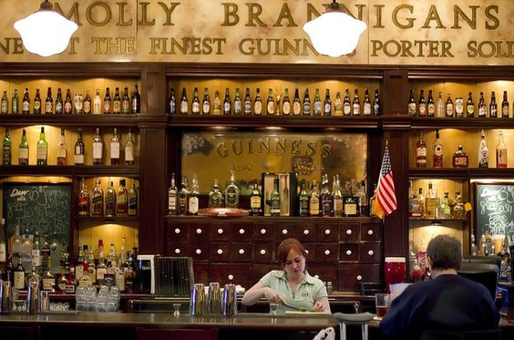 Supervisor Brook Nichols is framed by the beautiful ornate, carved dark wood bar at Molly Brannigans, a traditional Irish Pub and Restaurant located on N. Second Street in Harrisburg. CHRISTINE BAKER, The Patriot-News