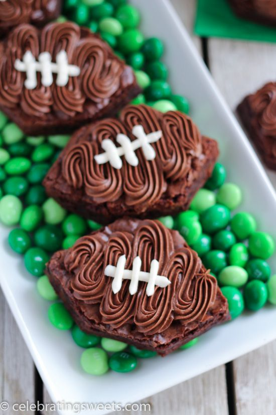 Brownies decorated to look like a football using chocolate and vanilla buttercream frosting. Use your favorite brownie recipe as the base, no cookie cutter needed!