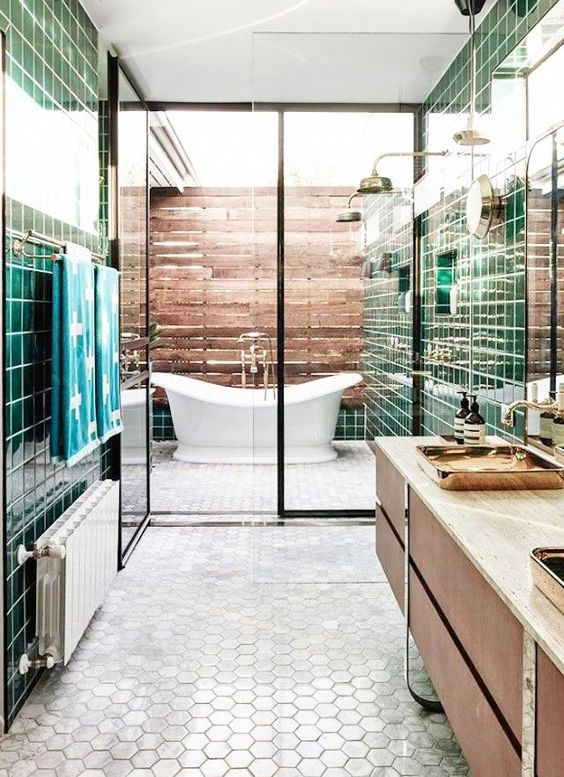 "We love this indoor/outdoor bathroom designed by Australian architecture firm Technä"". Privateâ yet outdoors, a freestanding porcelain tub is tucked right outside the master bathroom. It..."