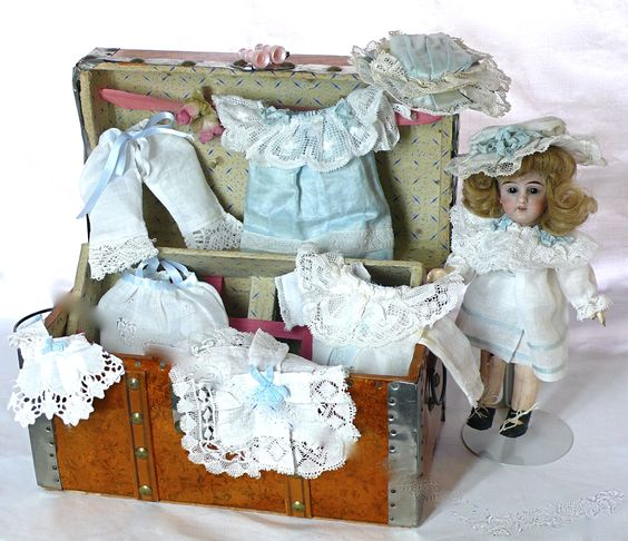 """""""Mignonette"""", antique German porcelain doll with her travel trunk."""