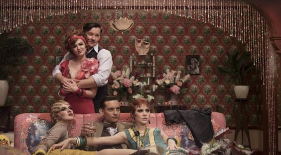 """Clockwise from top left) ISLA FISHER as Myrtle Wilson, JOEL EDGERTON as Tom Buchanan, ADELAIDE CLEMENS as Catherine, TOBEY MAGUIRE as Nick Carraway and KATE MULVANY as Mrs. McKee in Warner Bros. Pictures' and Village Roadshow Pictures' drama """"THE GREAT GATSBY,"""" a Warner Bros. © 2013 Bazmark Film III Pty Limited"""