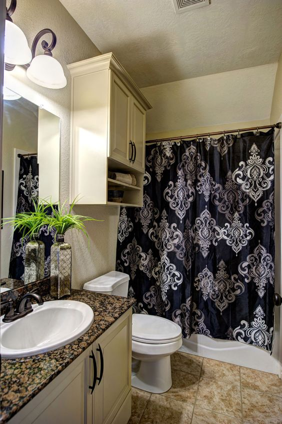 The guest bathroom is conveniently located in the hallway, features granite counter tops, ample storage space, and a tub/shower combo.