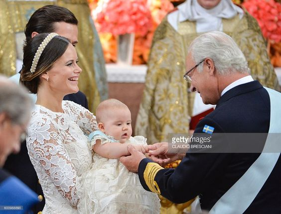 Princess Sofia (L) holds up her son Prince Alexander for King Carl Gustaf (R) at Palace Chapel in Drottningholm Palace in Stockholm at the christening of the five month-old Prince on September 9, 2016. / AFP / TT NEWS AGENCY AND TT News Agency / Claudio BRESCIANI / Sweden OUT        (Photo credit should read CLAUDIO BRESCIANI/AFP/Getty Images)