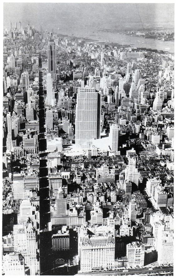 """vintagemanhattanskyline: """"Aerial view looking south of Midtown Manhattan in the Summer of 1933. Rockefeller Center with the 70-story RCA Building (Associated Architects, 1933) on the center and the..."""
