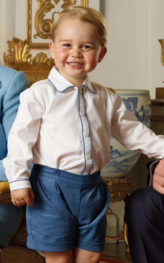 Prince George poses for a picture to be used on a postage stamp.