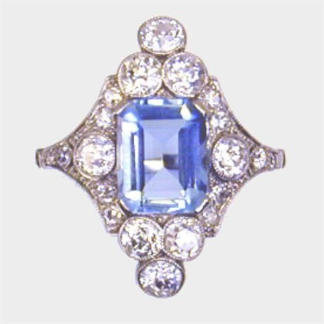 A MARQUISE SHAPED AQUAMARINE AND DIAMOND CLUSTER RING, C1920