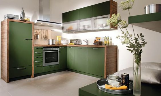 Khaki green cupboards with wood counter tops