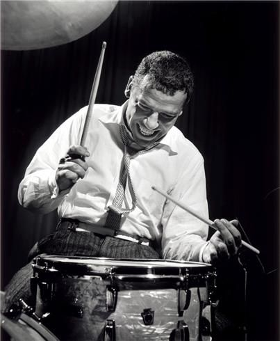 Buddy Rich, NYC, New York, 1954  © HERMAN LEONARD. One of the most recognizable drummers of all time, Rich performed with such jazz aristocracy as Dizzy Gillespie, Louis Armstrong, Tommy Dorsey and Gene Krupa. The heir apparent to Krupa's crown, Rich's infamous disdain for practice was just further proof of his prodigious talent.