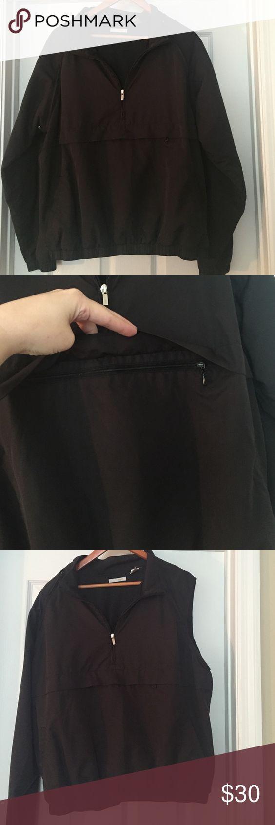 Liz Golf jacket/vest Black windbreaker jacket that converts to a vest (both sleeves zip on and off). Excellent condition. Has deep front zip pocket. Shell 100% polyester, lining 100% polyester Liz Golf Jackets & Coats