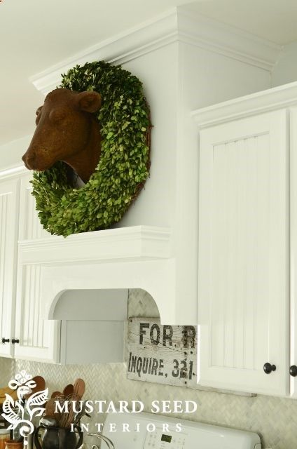 Marian's range hood.  Don't like the cow head, though.  Wonder how a hood like this would look with the 9ft ceilings....
