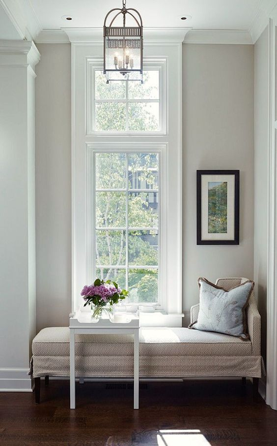 Nine Fabulous Benjamin Moore Warm Gray Paint Colors - laurel home | James Thomas interior design | side table by Oomph | A wonderful warm gray with a tiny touch of lavender is Benjamin Moore Abalone 2108-60 | fabulous architecture - love with transom window and pilaster | high ceilings | dark mahogany floors | cozy daybed | classic pendant lantern