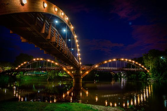The Tridge is the formal name of a three-way wooden footbridge spanning the confluence of the Chippewa and Tittabawassee Rivers near downtow...