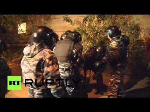 Video: Hundreds arrested following violent Moscow anti-migrant riot & cl...