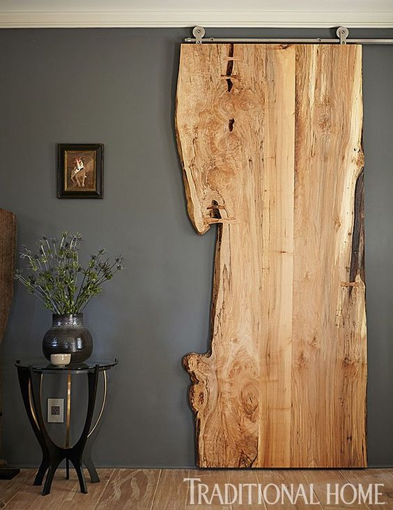 If it weren't for that metal track this piece of live edge wood would never suggest it actually serves as a door. Though it may not be a best option as a front door, it's definitely one of the most interesting sliding doors we could find.{found on traditionalhome}.: