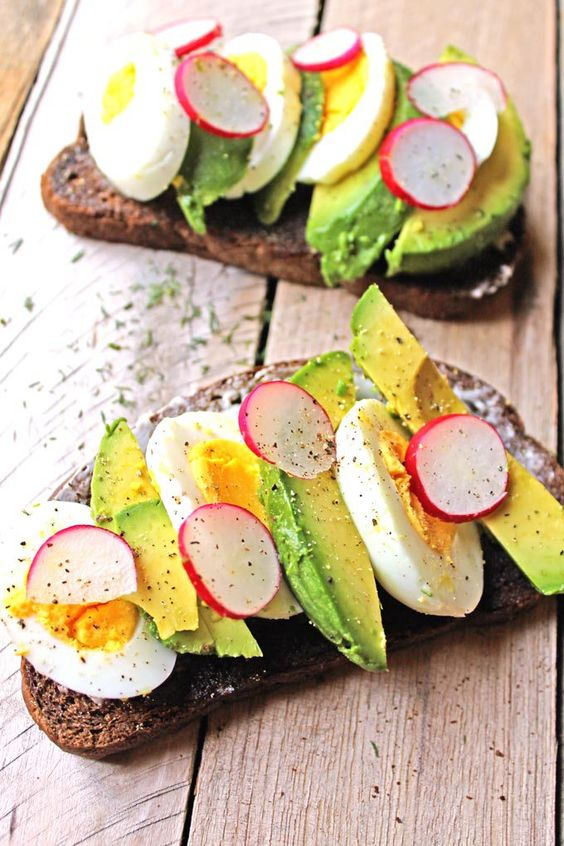 Smorrebrod with egg, avocado, and radish is an open faced sandwich on dark rye bread. Super healthy, fresh, whole foods. A Danish favorite!