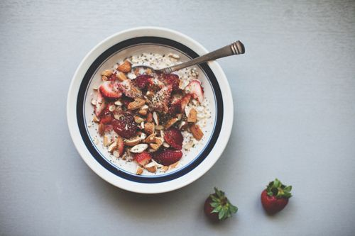 raw oats with berries, toasted almonds, and almond milk