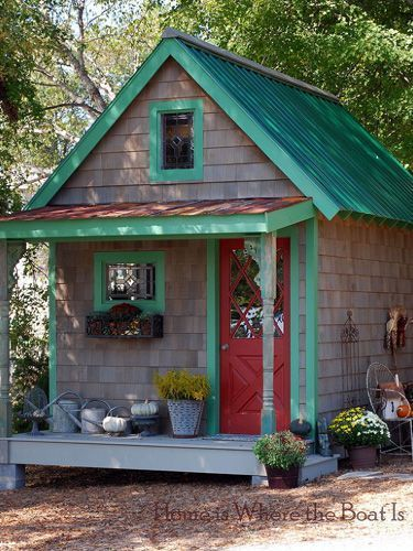Fall Potting Shed...This bold little potting shed gets a full themed costume every season! For fall, planters of mums and pumpkins galore line its mini porch. Could you imagine a better spot to inspire your green-thumb?